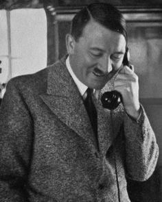 A rare photo of Hitler smiling and in mufti while talking to an early Nazi comrade, 1935. The photo was shot by Hoffman, Hitler's personal photographer until the end of the war.