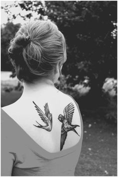 A beautiful pair of bird back tattoos for girls