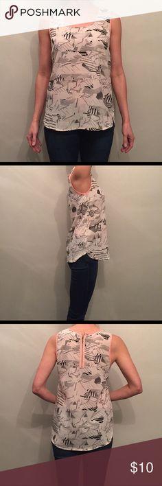 "Japna Geometric Print Tank Shirt Japna Geometric Print Tank Shirt. Black, white, gray, & pink. 100% polyester, semi transparent, zip closure with hook and eye on back. Very loose fit, my chest is 34C. Laying flat 17.5"" pit to pit, 18"" waist, shoulder to front hem 25.5"", back hem 26"". Japna Tops Tank Tops"