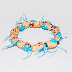 Kinderarmband van houten gelukspoppetjes   Bracelet for kids made of wooden lucky dolls   www.gelukkepuk.nl
