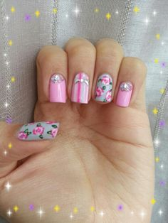 Roses, stripes, studs & crystals nails