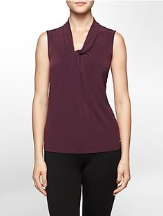 this sleeveless top features a drape knot scoopneck and logo plaque on the hem.