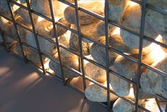 "Share 	Tweet 	Pin 	Mail  Set your patio, balcony, or other outdoor space aglow with this River Rock filled ambient light ""sculpture"", table, or seat.  Designed by Canadian artist, Zac Ridgely, the Hudson Cube is created with natural river stones … Read More..."