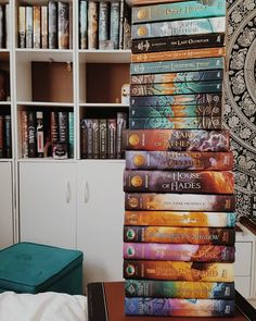"""129 Likes, 8 Comments - Haley • Blogger • Writer • 20 (@mythoughtsareabook) on Instagram: """"》 August 15th - Book Tower ---- 》 All of my Riordan books in one place. This toppled twice and…"""""""