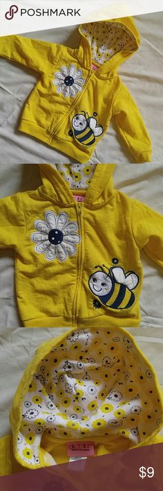 Carter's bumble bee hoodie Yellow hooded sweatshirt with cute bumble bee and flower detail. Flower print lining matches in the hood. Carter's size 12 months in great condition. Carter's Shirts & Tops Sweatshirts & Hoodies
