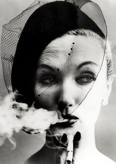 Model Evelyn Tripp photographed by William Klein ('Smoke and Veil') for Vogue, 1958.