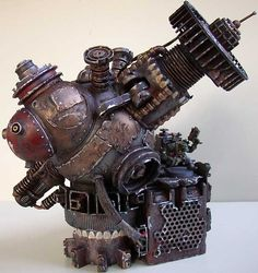 """Ork Mega Deff Ray Zzappa: Ork meks are capable of creating surprising feats of technology- often surprising even to them. This terrain piece is ideal for representing a variety of Ork contraptions, including a Tellyporta, Lifta Droppa, Kustom Force Field, or even a Deff Ray! Here a dilligent Mekboy can be seen on the maintenance platform, making a few """"ajustments""""."""