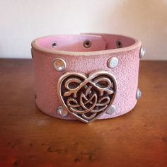 Women's pink leather cuff with studs and Celtic heart www.reddaisyartdesigns.com