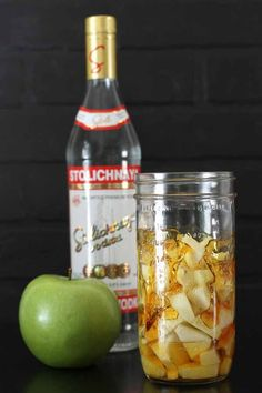 CARAMEL APPLE VODKA - so easy and so delicious! The favorite carnival food turned into an infused vodka - for gift giving, shot taking, or sipping over ice. Vodka Drinks, Cocktail Drinks, Fun Drinks, Yummy Drinks, Alcoholic Drinks, Summer Cocktails, Beverages, Christmas Cocktails, Mixed Drinks