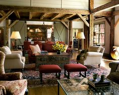 HILLTOP BARN HOUSE. Sliding Barn doors separate the Great Room from the Kitchen beyond. Robert Benson Photography