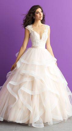 Allure Romance style 3007. A play of textures defines this romantic ballgown - ranging from ruffles to illusion netting. @allurebridals #AllureBridals #AllureRomance #bridal #ad #wedding #weddingdress #romantic #ballgown