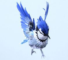 Gorgeous paper bird sculptures by Diana Beltran Herrera.