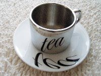 Anamorphic Tea Cups Illusion - http://www.moillusions.com/anamorphic-tea-cups-illusion/