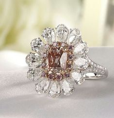 Earrings in this shape with colored stones would be pretty———