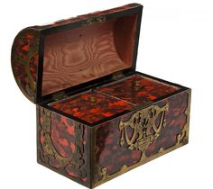 A gilt metal mounted tortoise shell tea caddy, Victorian, the domed and hinged cover opening a reveal a double lidded compartment, 8.5'' (22cms). (1).
