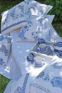Beautiful pillows; cups and saucers and teapot.  Lovely!