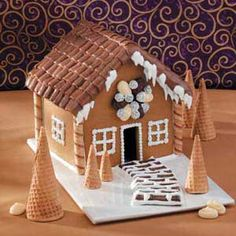We show just one way to decorate this cute little gingerbread house. Prepare several batches of dough (one batch at a time) and decorate a number of houses in different ways to create a gingerbread village. —Taste of Home Test Kitchen Gingerbread House Patterns, Gingerbread Village, Christmas Gingerbread, Gingerbread Men, Gingerbread Cookies, Pirouette Cookies, Sugar Cones, Piping Icing, Galletas Cookies
