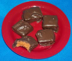 Home-made Butterfingers!    1 lb. candy corn   16oz jar peanut butter (any brand you prefer)   16oz pkg. chocolate candy coating     Melt candy corn in microwave on high 1 minute. Stir and continue cooking in 15-second intervals til melted, stirring after each interval. Stir in peanut butter. Spread mixture in an 8x8 pan lined with parchment. Cool completely. Cut into squares. Dip in melted chocolate candy coating. Lay on waxed paper to set.