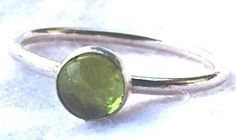 Peridot Ring, Peridot Silver Ring, Stacking Ring. This handmade peridot ring is bezel set with 6mm peridot cabochon on 925 sterling silver band. August's birthstone, peridot is a fresh and cheerful pop of color worn alone or stacked with other rings. Peridot goes with so much!  Comes in sizes 4-12, including half sizes. This MADE TO ORDER ring takes 6 business days before shipping, but I always do my best to get it to you sooner.Arrives tastefully packaged for you to present as a gift to...