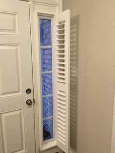 Eclipse plantation shutters, 2 1/2 inch louver with tilt open view.