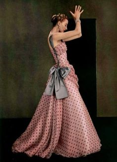 Model wearing a pink, polkadotted evening gown by Madame Grès, Spring 1953- so  pretty