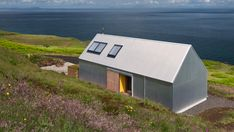 Rural Design has completed a holiday home on Scotland's Isle of Skye, featuring corrugated aluminium walls that reference local sheds