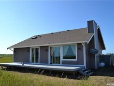 Coming home to this house each day would make every day a good one. #OceanShores #RealEstate Ocean Shores, Getting Cozy, Full Bath, Open House, Shed, Deck, Floor Plans, Real Estate, Outdoor Structures