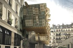 architizer:        A fluctuating facade of wood pallets designed by French architect Stephane Malka.
