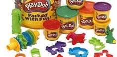 Play-Doh....I had the little stamps and cutters. The hole for pushing the Play-Doh out after you cut it.