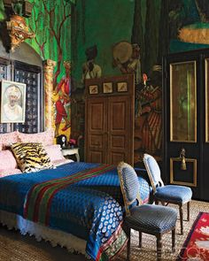 the master bedroom in the san antonio, texas home of designer gwynn griffith featuring a mural of a persian landscape by greg mannino, a headboard made of faux marble pilasters, indian pierced-wood doors, italian chairs, and an irish carpet; photographed by william waldron for elle decor