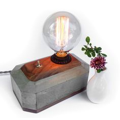 This beautiful handmade Concrete + Walnut Desktop Edison Lampwith American Black Walnut cover is 7 inches by 5 inches, and 4 inches high not including the height of the bulb. The speciality edison bulb emits a warm cozy glow, and is included. Concrete Light, Concrete Lamp, Concrete Tools, Concrete Design, Desk Light, Lamp Light, Handmade Desks, Wooden Table Lamps, Edison Lamp