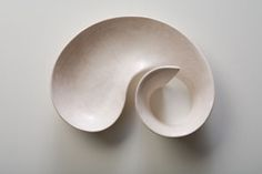 You should look at her creations; they move, they flow, they are like what normal ceramic forms secretly want to be.  Tina Vlassopulos
