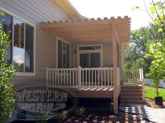 Attached pergola with custom stain and Crescent profile. Deck, stairs, and handrail.