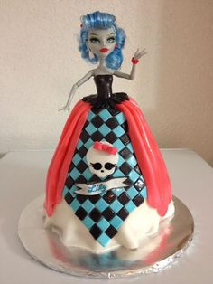Barbie monster high*doll stuck into cake all of the dress is in fondant