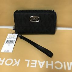Sale~Michael kors wristlet/wallet black Authentic brand new with tag. Limit sale time seasonal. Michael Kors Bags Clutches & Wristlets