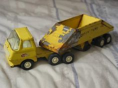 A Junkee Shoppe Junk Market Stop: TONKA Bottom Dump Pressed Steel Truck Toy Vehicle ... For Sale Click Link Here To View >>>> http://ajunkeeshoppe.blogspot.com/2015/12/tonka-bottom-dump-pressed-steel-truck_18.html
