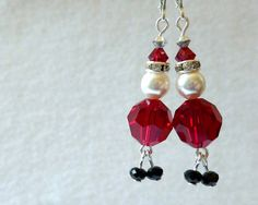 These darling Santa earrings with their dangly feet feet are made with assorted Swarovski crystals, Swarovski crystal rondelle spacers, and