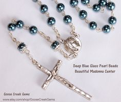 SALE, SALE, SALE! ALL ITEMS ARE MARKED DOWN!  Use the coupon code GOOSECREEK when you check out to take an ADDITIONAL 10% OFF your purchase from now until JULY 13th!  Blue Madonna Glass Pearl Rosary  $25.77 https://www.etsy.com/listing/123362952/blue-madonna-glass-pearl-rosary