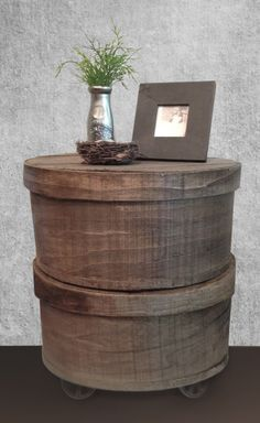 Vintage cheese boxes upcycled into a side table with industrial castor feet, created by designer Stephanie Reppas, October Design Co.