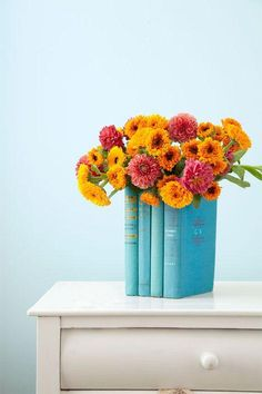 Give damaged books a new lease on life by transforming them into a vase