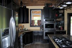 Nice 50+ Attractive Black and White Kitchen Cabinet Ideas http://decorathing.com/kitchen-ideas/50-attractive-black-and-white-kitchen-cabinet-ideas/