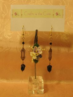 Simple Goldtone Delicate Flower Stamping with Black Tulip Flower Earrings by crafts4thecure, $5.00