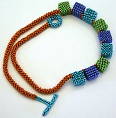 Nita E Kaufman-Right-angle weave necklace with peyote toggle. Cube beads are solid beads - no supporting structure inside.