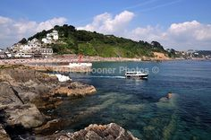 A boat heads out to sea at Looe, South East Cornwall - Looe in  Cornwall