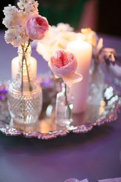 pretty take on a vintage, candle/bottle combination centerpiece