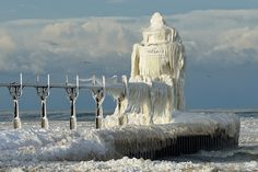 winter hits st. joseph lighthouse, michigan lake photo