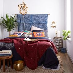 Jump into bohemian bedroom style with rich colors, tons of textures, and whimsical detailing all working together in perfect harmony.