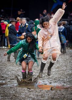 Still wish you were there? Hail, rain and lightning storms leave Glastonbury a mud-bath...but at least the revellers are putting on a brave face