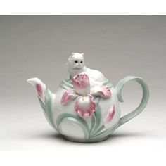 Features:  -Care Instruction: Hand wash only.  -Material: Ceramic.  -Teapot can fit 20 oz.  -Hand painted.  Color: -Green/Pink.  Material: -Ceramic.  Pattern: -Floral. Dimensions:  Overall Height - To