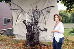 Recorder/Paul Franz<br/>Deerfield  artist Trisha Moody-Bourbeau stands with the dragon she created for a customer by welding together tools and other scrap metal.